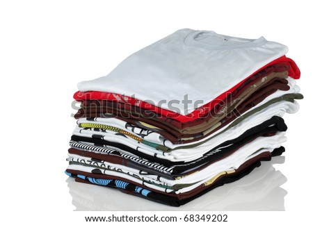 stack of t-shirt and clothes, over white background - stock photo