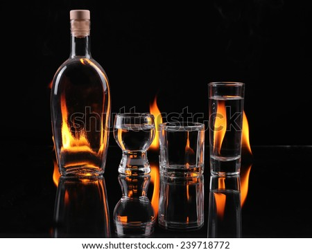 Stack of tequila on fire - stock photo