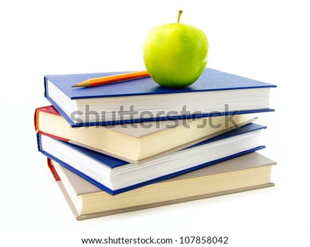 Stack of textbooks with apple and pencil on top, over white
