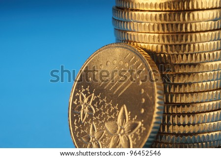 stack of the coins on the blue background