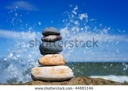Stack of the pebble against background  of the  water droplets