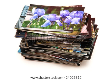 Stack of the photos, isolated on a white background - stock photo