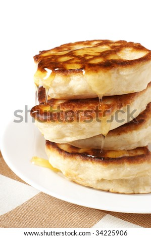 Stack of thick pancakes with honey close-up.