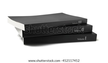 Stack of Three Black Cover Books on white Background - stock photo