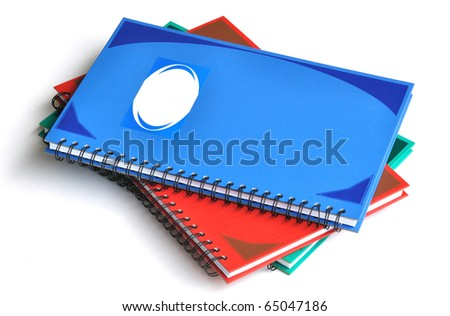 Stack of three color rectangular notebooks - stock photo