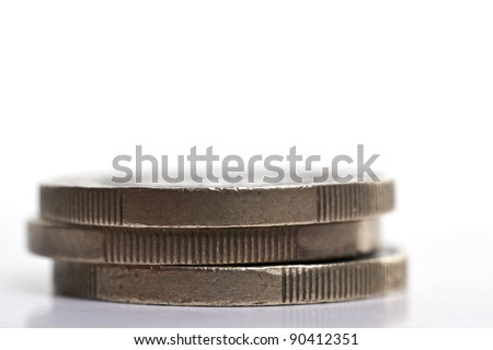 Stack of three 1 Euro coins over a plain background - stock photo