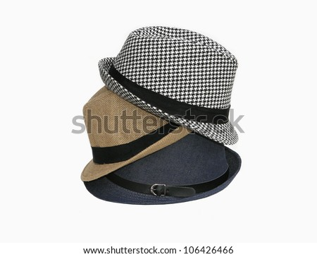 Stack of three fedora hats isolated on white background - stock photo