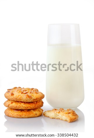 Stack of three homemade peanut butter cookies, half of cookie and glass of milk, isolated on white background - stock photo