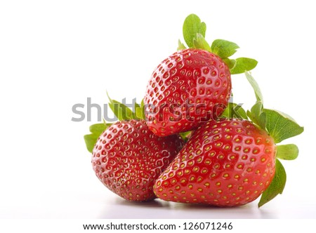 Stack of Three Strawberries Isolated on White Background - stock photo