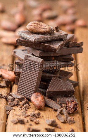 Stack of tiles dark chocolate and cocoa beans - stock photo