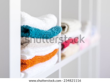 Stack of towels in the linen closet . - stock photo