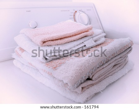 Stack of towels on the dryer. - stock photo