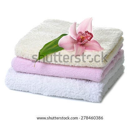 stack of  towels with pink orchid flower isolated on white - stock photo