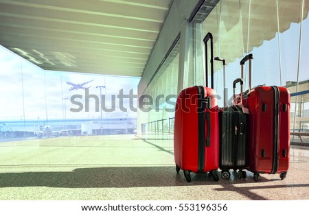 stack of traveling luggage in airport terminal and passenger plane flying for air transport and traveling theme