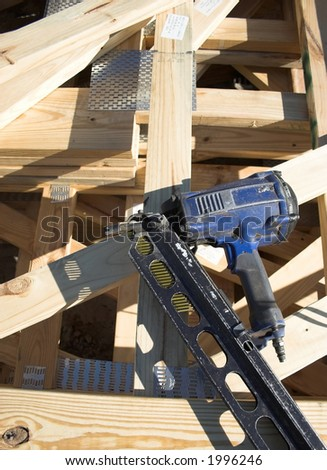 stack of trusses with nail gun on top - stock photo