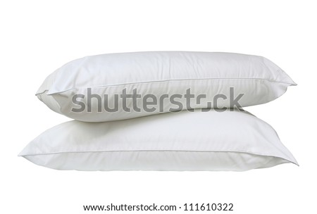 Stack of two fresh, new white bed pillows isolated over white - stock photo