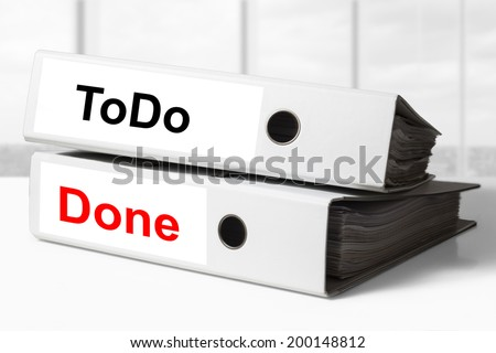 stack of two white office binders todo done - stock photo