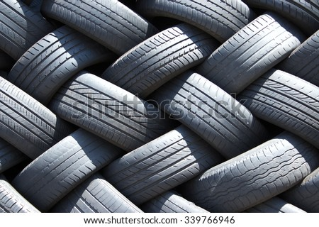 Stack of used car tires in the garage - stock photo