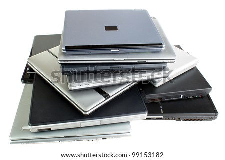 Stack of used laptop computers, isolated on white - stock photo