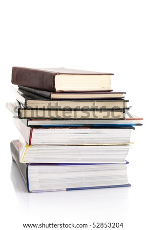 Stack of various books isolated on white background. - stock photo