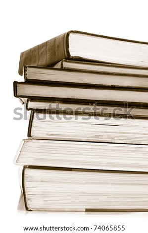 Stack of various books on white background. Toned image.