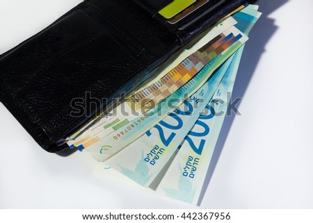 Stack of various of israeli shekel money bills in open black leather wallet - Top view. - stock photo