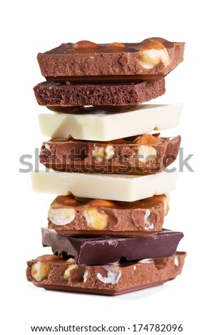 stack of various  pieces of chocolate  on white background