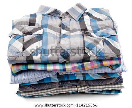 Stack of Various Plaid Men's Shirts isolated on white background - stock photo
