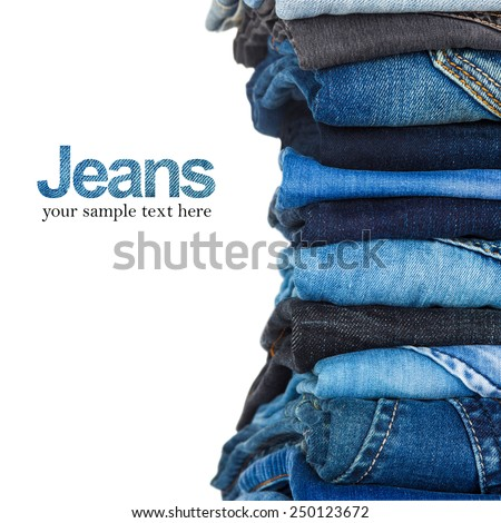 stack of various shades of blue jeans on white background - stock photo