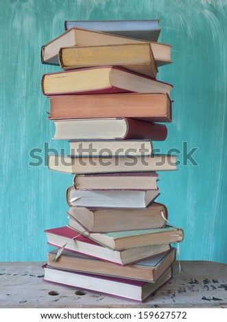 stack of vintage books - stock photo
