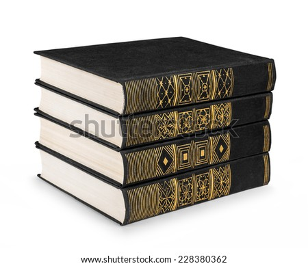 stack of vintage books black with gold pattern on a white background isolation