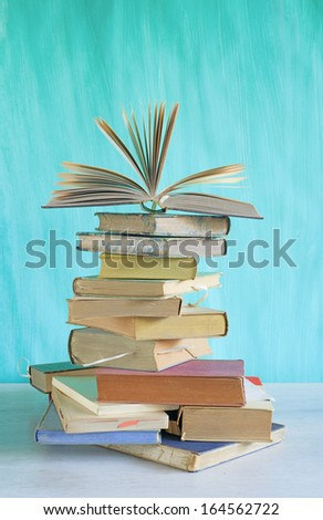 stack of vintage books, free copy space on the background - stock photo