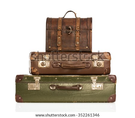 Stack of vintage leather suitcases isolated on white background - stock photo