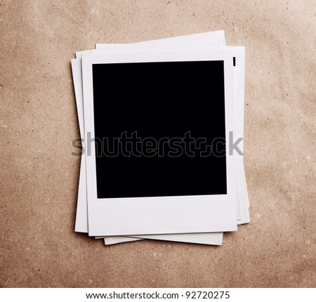Stack of vintage photos at recycled paper with clipping path - stock photo