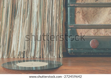 Stack of vinyl records and old player - stock photo