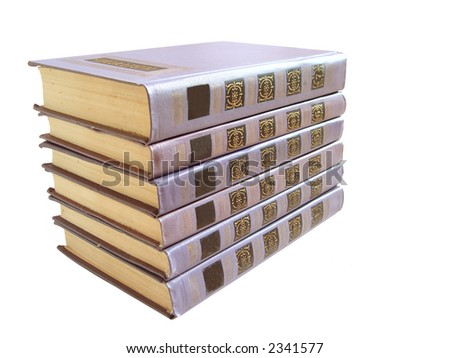 stack of violet books with numbers over white background - stock photo