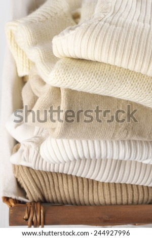 Stack of warm sweaters close-up.