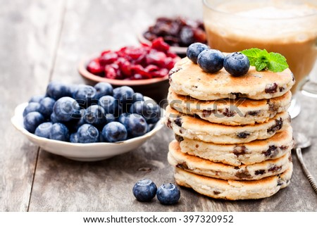 Stack  of welsh cakes with blueberry and a cup of coffee  - stock photo