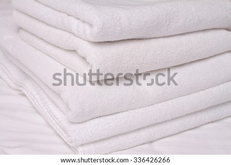Stack of white and soft towels. Using Laundry Detergents  conditioners.