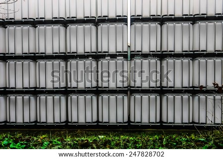 Stack of white chemical plastic container - stock photo