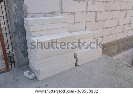 stack of white Lightweight Concrete block, Foamed concrete block, raw material for industrial wall or house wall - stock photo