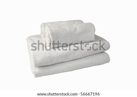 Stack of white spa towels [with Clipping Path and isolated on white background] Stack of white spa towels rolled and folded on top of each other. - stock photo