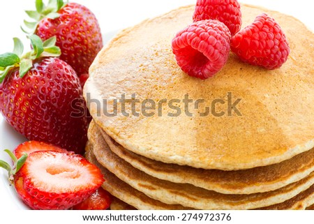 Stack of whole grains pancakes with fruits - stock photo