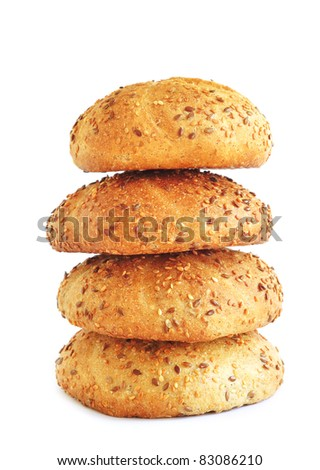 Stack of wholegrain buns with sesame, isolated - stock photo