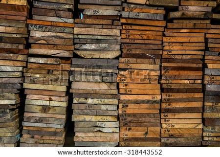 stack of wood -  brown blank plank surface grunge wooden wall floor frame exterior panel timber material grey background  - stock photo