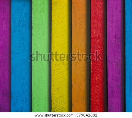 stack of wooden boards in different colors