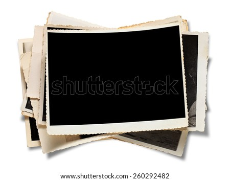 Stack Old Photos. Isolated on white background. - stock photo