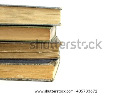 Stack on antique books isolated on white background.