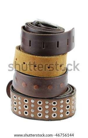 stack pile of leather belts isolated on white background - stock photo
