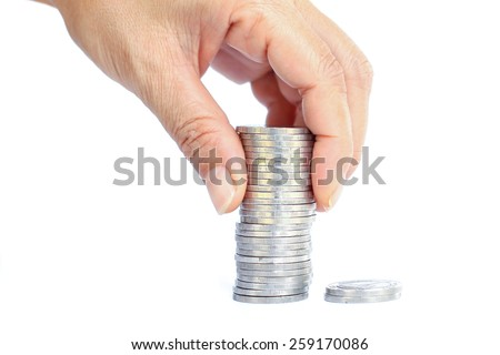 stack silver coins with reflection and hand with coin isolated on white.